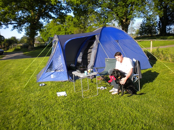 One man and his dog at Deanwood campsite Forest of Dean